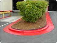 Bright Red Concrete Curb Paints.